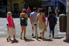 A group of people crossing the street in Madrid stock image