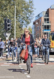 Group of people cycling in city center, Amsterdam, netherlands Stock Photos