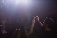 Group of people dancing at a concert Stock Photography