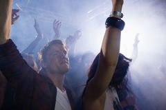 Group of people dancing at a concert Stock Photo