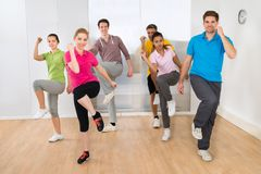 Group of people dancing in gym Stock Photos