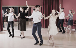 Group people dancing lindy hop in pairs. In dance hall Stock Photos