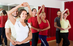 Group of people dancing salsa in studio royalty free stock photography