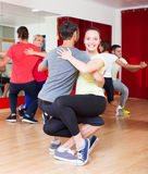 Group of  people dancing salsa in studio Royalty Free Stock Images