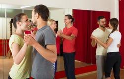 Group of people dancing salsa in studio Stock Photo
