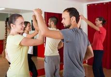 Group of people dancing salsa in studio Royalty Free Stock Image