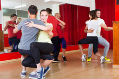 Group of people dancing salsa in studio. Group of spanish people dancing salsa in studio royalty free stock photography