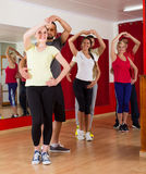 Group of people dancing salsa in studio Stock Images
