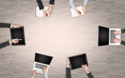 Group of people with devices in hands having desk discussion and working on laptops, tablets in team. Group of people with devices in hands having desk royalty free illustration