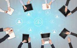 Group of people with devices in hands working on laptops and tablets with office concept. Group of people with devices in hands working in team on tablets royalty free stock images