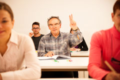 Group of people of different age sitting in classroom and attend Royalty Free Stock Photos
