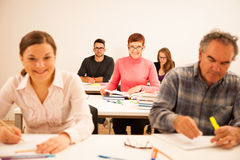 Group of people of different age sitting in classroom and attend Stock Images