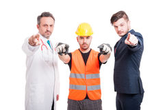 Group of people with different jobs. Standing together and blaming you on white background Stock Images