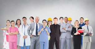 Group of people with different professions standing in front of blank grey background stock photo