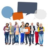 Group of People with Digital Devices and Speech Bubbles Royalty Free Stock Image