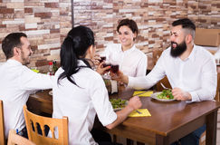 Group of people dining out in restaurant Stock Photo