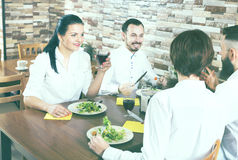 Group of people dining out in restaurant Royalty Free Stock Photos