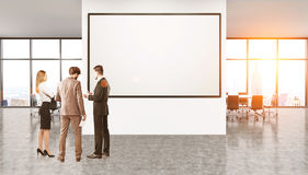 Group of people discussing business. Group of businesspeople standing in New York office in front of whiteboard discussing work issues. Concept of team and Stock Images