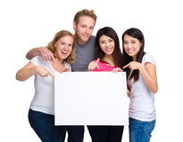 Group of people with diverse ethnicities holding blank sign for Stock Image