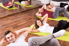 Group of people doing abs Royalty Free Stock Photos