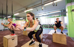 Group of people doing box jumps exercise in gym Stock Photography