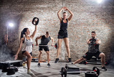 Group of people doing different exercising Stock Photos