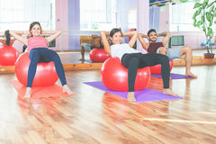 Group people doing exercise with fitness ball Royalty Free Stock Photos