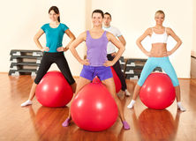 Group of people  doing  exercises in a gym. Smiling young  people doing  exercises in a gym Royalty Free Stock Photography