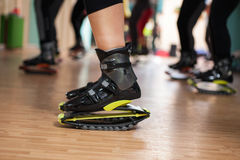Group of people doing exercises with  kangoo shoes Royalty Free Stock Photos