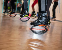Group of people doing exercises with  kangoo shoes Royalty Free Stock Images