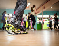 Group of people doing exercises with  kangoo shoes Stock Image
