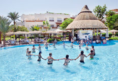 Group of people doing exercises in the pool Stock Images