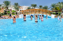 Group of people doing exercises in the pool Stock Photo