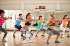 Group of people doing exercises for shaping body Royalty Free Stock Images
