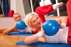 Group of people doing fitness exercise Stock Image