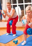 Group of people doing fitness exercise Stock Photo