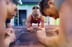 Group of people doing plank exercise in gym Royalty Free Stock Image