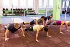 Group of people doing push-ups in gym Stock Photography