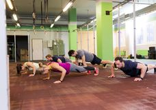 Group of people doing push-ups in gym Royalty Free Stock Photography