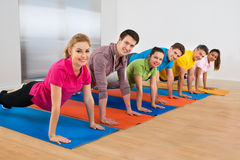 Group Of People Doing Push Ups Royalty Free Stock Photo