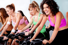 Group of people doing spinning Royalty Free Stock Photos