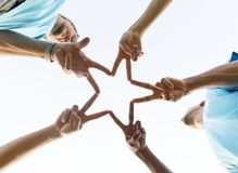 Group of People Doing Star Handsign royalty free stock photo