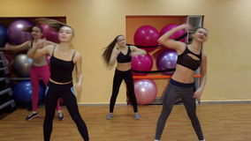 Group of people doing stretching exercise in a sports club. stock video