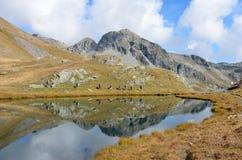 Group of people doing trekking near Lake Palasina, Aosta Valley, Italy Royalty Free Stock Photography