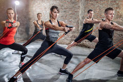 Group of people doing workout with elastic band royalty free stock image