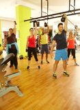 Group of people doing workout in gym. Group of people doing fitness workout in gym with dumbbells Royalty Free Stock Photo