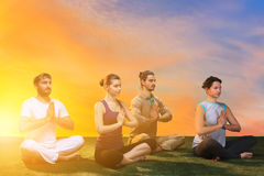 The group of people doing yoga exercises Stock Images