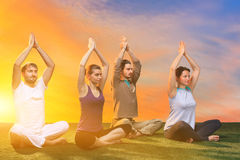 The group of people doing yoga exercises Stock Image