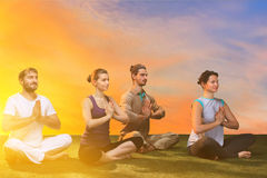 The group of people doing yoga exercises Stock Photo