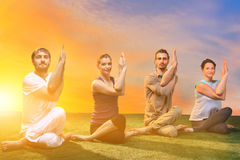 The group of people doing yoga exercises Royalty Free Stock Images